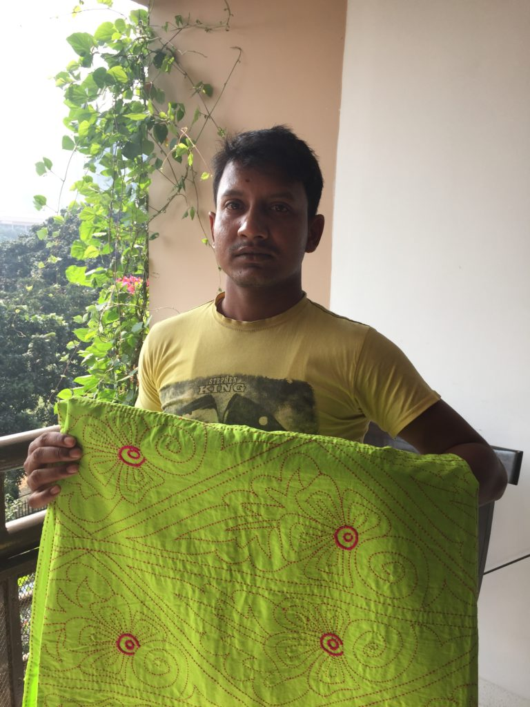Nakshi Kantha trader Mohammed Hussain with one of his beautiful wares
